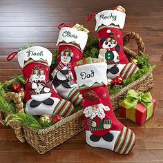 Winter Wonderland Stockings - A Personal Creations Exclusive! Our fanciful felt stocking has a green-and-red striped toe with a matching cuff draped in snow. Choose from an array of beloved winter characters: Santa, Mrs. Claus, Snowman, Moose, Bear, Penguin, Cat or Dog.