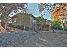 56 AMESTI Road, Watsonville, CA 95076 - $445,000 / beds: 3 / baths: 1 Full,1 Partial - This remodeled home boasts nearly 1/2 acre huge, flat lot with beautiful trees. Kitchen is nicely updated w/granite counters,stainless appliances,tile floors. Built ins in dining room. View deck off living area. Large bathroom w/travertine tile. Bonus sauna AND don't miss the downstairs workshop/man cave w/1/2 bath. Home sets off road. Private feel, yet close in. New paint, new carpet, super clean