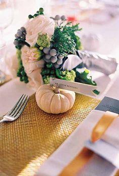 Pumpkins make great escort card holders | Brides.com