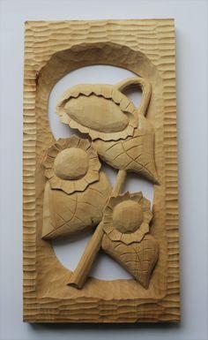 Slunečnice+Slunečniceručně+vyřezávané+z+lipového+dřeva,+povrchová+úpravadokončena+včelím+voskem.+Poslouží+jako+dekorace+do+bytu,+nebo+na+chalupu.+rozměry+35x18+cm