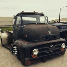1953 1954 1955 Ford F100 F-100 COE Cab Over Engine sitting on a modern chassis with spike lug nuts and widened rear fenders to cover the dually rearend.