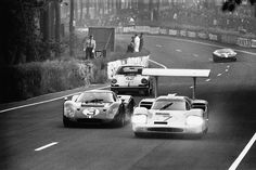 The Phil Hill/Mike Spence Chaparral 2F leads the Mario Andretti/Lucien Bianchi Ford GT40 Mk IV, the Robert Buchet/Herbert Lin Porsche 911S, and another at the 1967 24 Heures du Mans.