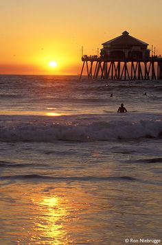 Huntington Beach, CA  Part of the whirlwind west coast trip. The water was freezing, and I felt disoriented. This Tidewater girl is used to having the ocean on her right when walking north on a beach.