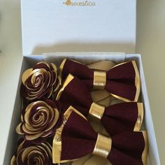 Burgundy, maroon and gold bow tie and matching lapel boutonnières