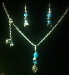 Homemade dolphin earring and necklace set
