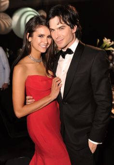 "Nina Dobrev and Ian Somerhalder. Love them on TVD!!! Nina is beautiful and Ian is gorgeous with that little smirk...I can almost hear him thinking, ""Smiling??? That's so overrated. Just smirk. It will make people wonder what you're thinking about."" LOL It's a very Damon-like thing to think....."