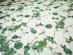 Hey, I found this really awesome Etsy listing at https://www.etsy.com/listing/171072378/emerald-green-embroidered-lace-fabric