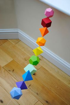 Make a platonic solids garland with these templates  (or just make some Tron bits...).  Via .  Here are two more projects from the same si...