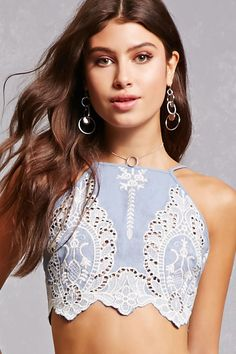 1af4b9cebf6a A woven crop top featuring an embroidered lace design