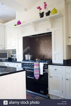 Black range oven alcove with mosaic tiling in traditional kitchen with fitted white units - Stock Image Range Cooker Kitchen, Aga Cooker, Kitchen Units, Kitchen Doors, Kitchen Cabinets, Kitchen Ideas, Black Range Cooker, Black Cooker, Aga Oven