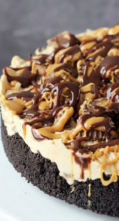 Ultimate No Bake Reese's Peanut Butter Cup Cheesecake Recipe ~ This cheesecake is over flowing with rich peanut butter flavor.
