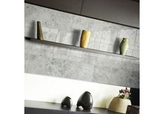 Silver Shadow Polished marble 40.6x40.6cm is a large format tile, where soft silver and light shades mix beautifully together to give a modern feel that will enrich any home. Just £7.58 per tile