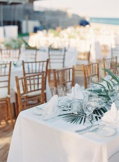 Palm table runner | Photo via Project Wedding