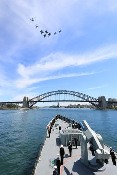 RAAF aircraft lead in the fleet during the Royal Australian Navy's International Fleet Review on Sydney Harbour