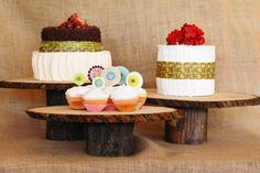 Cupcake stands that are made of wood.
