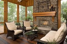 Sunroom with a fireplace - so want this on the back of the house!