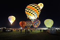 The night sky is the perfect backdrop for these majestic balloons during the Albuquerque International Balloon Fiesta (AIBF). Photo: Paul deBerjeois