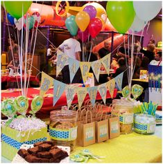 Dessert table with 'Thank You' bags as parting gifts