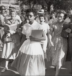 It was the fourth school year since segregation had been outlawed by the Supreme Court. Things were not going well, and some southerners accused the national press of distorting matters. This picture, however, gave irrefutable testimony, as Elizabeth Eckford strides through a gauntlet of white students, including Hazel Bryant (mouth open the widest), on her way to Little Rock's Central High.