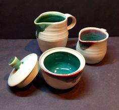 Jugs and sugar bowl, porcelain with white and copper glaze Annie Jennings