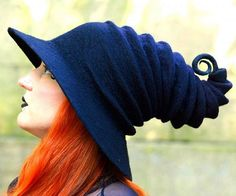 Put the finishing touches on your spooky witch costume by accenting it with this black witch hat. This stylish hat is handblocked from 100% wool and given a smooth and continuous curvy shape to add a bit of whimsy to your ensemble.