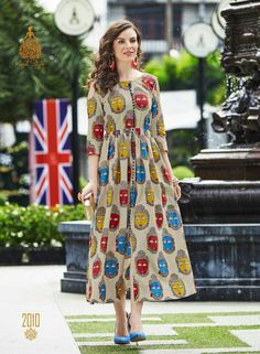 Get a dose of freshness with this multicolor tunic, printed all over in lawn cotton. With a front slit and yoke detailings, the design is a perfect pick. Kurta Designs Women, Kurti Neck Designs, Salwar Designs, Blouse Designs, Kalamkari Dresses, Ikkat Dresses, Cotton Tunics, Cotton Dresses, Kalamkari Designs