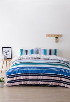 Rest easy with this offbeat striped duvet cover. Combining vibrant blue, lilac and rose pink with deeper tones of teal and navy, this duvet cover mixes pinstripes and wide stripes for a unique look you'll love. Wide Stripes, Quito, Duvet Cover Sets, Pink Roses, Lilac, Comforters, Bedding, Rest, Blanket