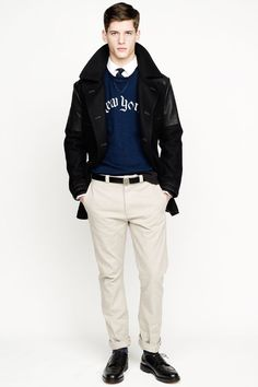 Shop this look on Lookastic:  http://lookastic.com/men/looks/crew-neck-sweater-longsleeve-shirt-tie-pea-coat-belt-chinos-brogues/5788  — Navy and White Print Crew-neck Sweater  — White Long Sleeve Shirt  — Navy Polka Dot Tie  — Black Pea Coat  — Black Leather Belt  — Beige Chinos  — Black Leather Brogues