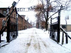 """Far too few survived after entering a Nazi extermination camp even though the banner over the gate promised that """"work sets you free."""" This slogan appeared at Auschwitz (above) and other camps."""