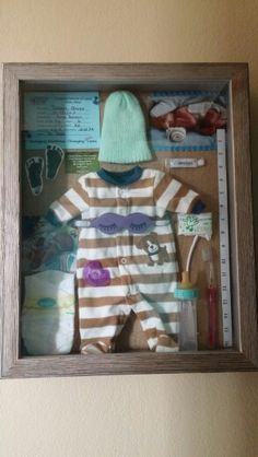 My shadow box I created for my little boy all thethinga that he had and his first memories from the hospital. His preemie stuff oncluded as well as information, pictures, and medical neccessities. Absolutely loved this when I got it done!