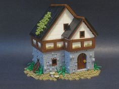 Brick Wizard built a nice medieval cottage. The clean build is full of great textures, including the stonework and landscape.