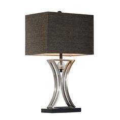 This modern table lamp features an hourglass shape and pendulum design. The chrome finish body, black base and charcoal grey rectangular shade complement this current look.