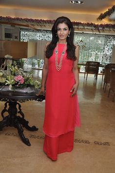 Raveena Tandon looks effortlessly elegant in this red outfit by Anita Dongre.