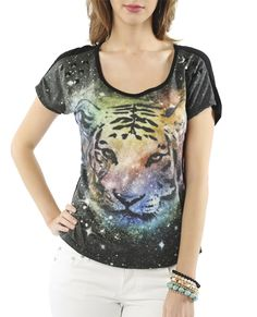 Crop knit tees are simply the best for comfort and style! This one features a soft knit body and large cosmic tiger with pyramid studs, scoop neckline and short sleeves.