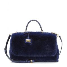 Dolce & Gabbana - Fur and snakeskin shoulder bag - We are head-over-heel for this fur shoulder bag from Dolce & Gabbana. A luxury status symbol in itself, the petite design is finished with a tonal snakeskin top handle and detachable shoulder strap. Wear it during the day to add opulence to your looks, or carry it next to cocktail dresses at night. seen @ www.mytheresa.com