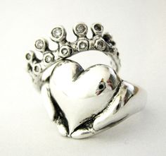 Anyone with some Irish and, more importantly, freckles needs a claddagh.--this is the most unique claddagh I've ever seen! I love it. I need to find mine.