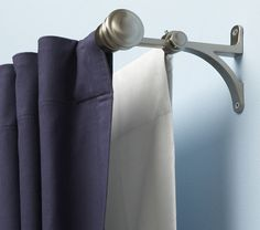 Consider hanging blackout curtains behind your window treatments to block unwanted light. Double curtain rod.