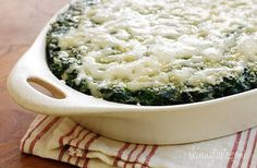 Makeover Spinach Gratin - Creamy spinach with a hint of nutmeg is baked in the oven topped with melted cheese for guiltless decadent Holiday side dish.