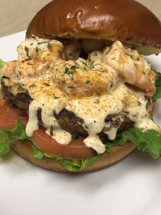 The Louisiana/Texas Border Burger also available from 11am until 2pm drop by and pickup one or two.  17527 Huffmeister Rd Cypress,Texas 77429 Grilled Angus burger topped with blackened shrimp , garlic and Asiago cheese aioli with lettuce and tomato on a brioche bun $9.50 #LunchisReady Angus Burger, Cypress Texas, Brioche Bun, Blackened Shrimp, Asiago Cheese, Aioli, Salmon Burgers, Lettuce, Louisiana