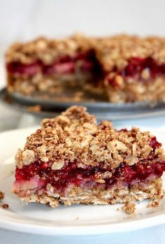 Raspberry Rhubarb Coconut Crumble Bars [Vegan, Gluten-Free] - One Green PlanetOne Green Planet Sweet Desserts, Sweet Recipes, Delicious Desserts, Yummy Food, Healthy Cake, Healthy Sweets, Raspberry Rhubarb, Vegan Baking, Dessert Bars