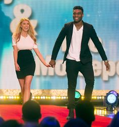 Description of . Charlotte McKinney and Keo Motsepe during the 'Dancing with the Stars' cast announced on Tuesday, February 24, 2015. (ABC/Todd Wawrychuk)