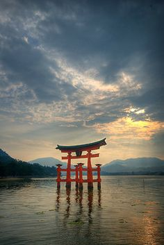 visitheworld:  Torii of Itsukushima Shrine at sunset in Miyajima, Japan (by jaudrius).