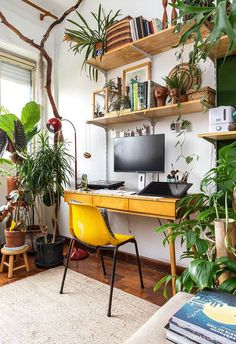 a bright boho home office with open shelving a retro desk a yellow chairs and lots of potted plant a bright boho home office with open shelving a retro desk a yellow chairs and lots of potted plant M nbsp hellip furniture makeover Home Office Furniture Design, Apartment Interior Design, Home Office Design, House Furniture, Cozy Home Office, Home Office Decor, Retro Desk, Retro Office, Appartement Design
