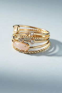 Anthropologie Mix & Match Ring Set. love these beautiful stacking rings in rose, gold and mint. Set of five. 12K gold plating, opal, cubic zirconia, rose quartz, sapphire, glass stones. Imported. Great christmas gift idea for wife, girlfriend, sister, mom or friend. #anthropologie #anthrofave #ad #affiliate #ring #rosegold
