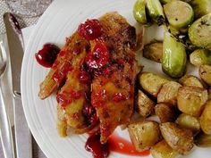 Get Ted Allen's Crisp-Tender Roast Duck with Cherry-Rosemary Sauce Recipe from Food Network