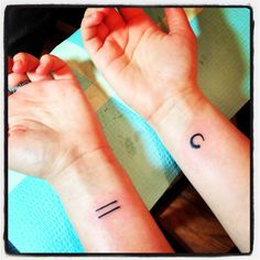 The left is an equal sign, symbolizing the fight for equality. The right is a enso, symbolizing an ongoing journey.