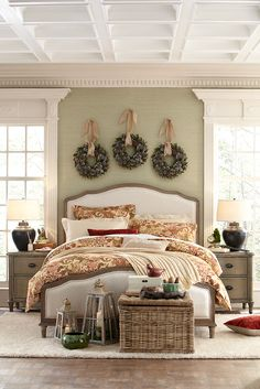 Hang three wreaths in a row over your bed or in your living room for a fresh take on holiday decor.