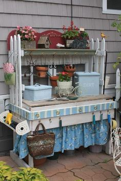 POTTING bench made from (2) old windows, (1) old picket fence, (1) old work bench and (1) foot-board of a bed turned upside down!