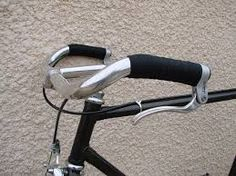 Resultado de imagen para palanca de freno bicicleta para tirar dos cables a la vez