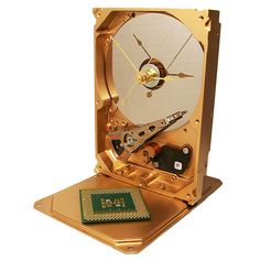 Striking Painted Golden Hard Drive Clock, from a Recycled Hard Drive. Has CPU Accent.. $44.00, via Etsy.